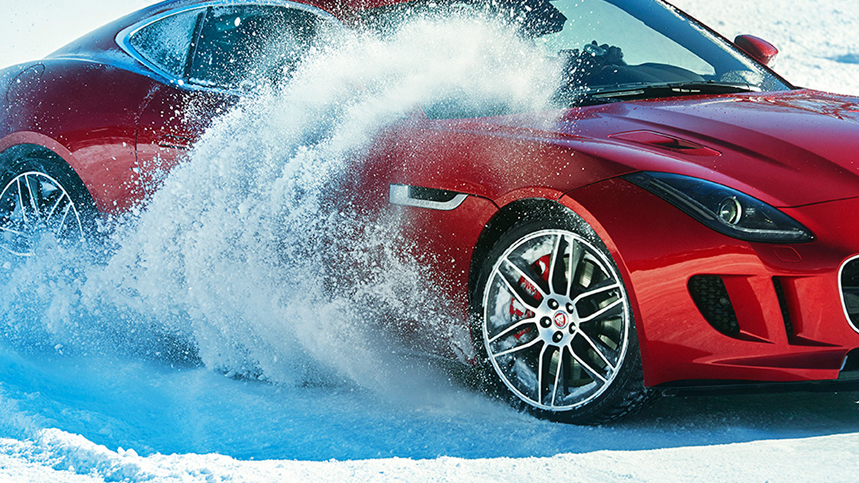 Jaguar f-type wheel kicking up ice on an ice track.