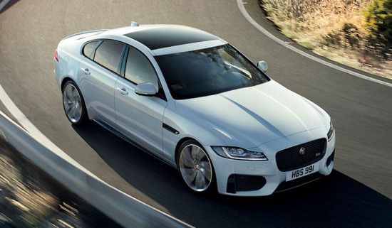 White XF saloon driving on highway.