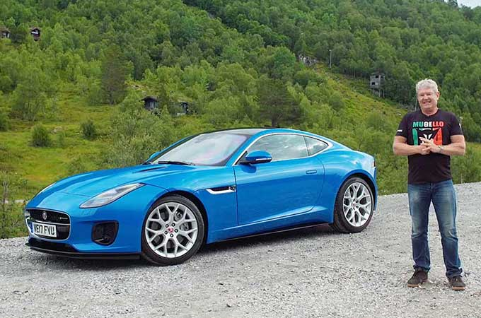 Anthony Crowford standing next to a blue jaguar F-Type.