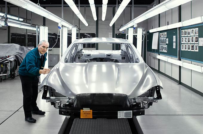 Silver Jaguar being assembled in factory.