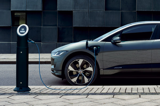 Jaguar I-PACE parked and charging on a roadside