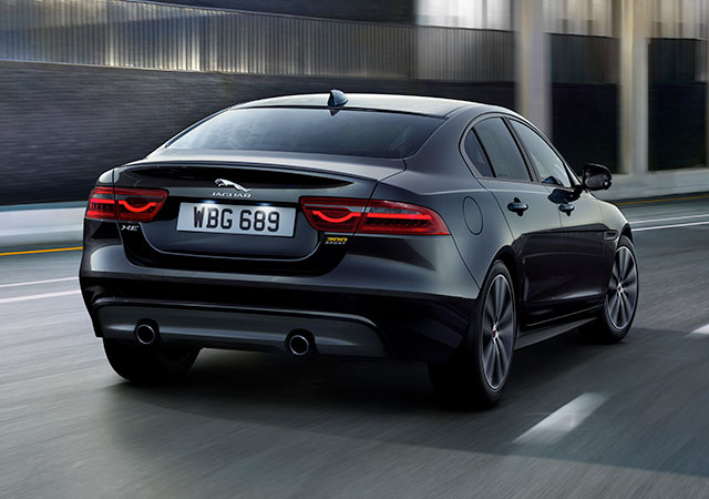 Jaguar XE 300 Sport Saloon drives along an urban road