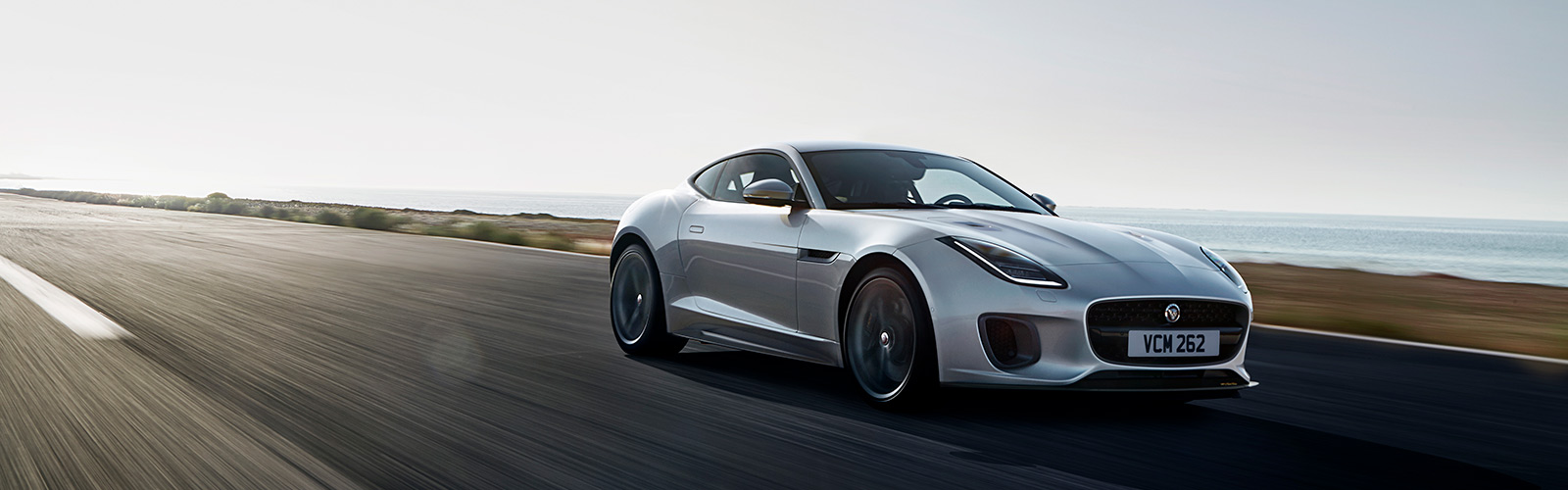 Close-up of Jaguar F-TYPE driving on-road