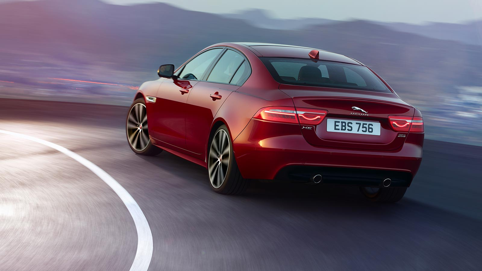 Rear view of Jaguar XE S cornering.