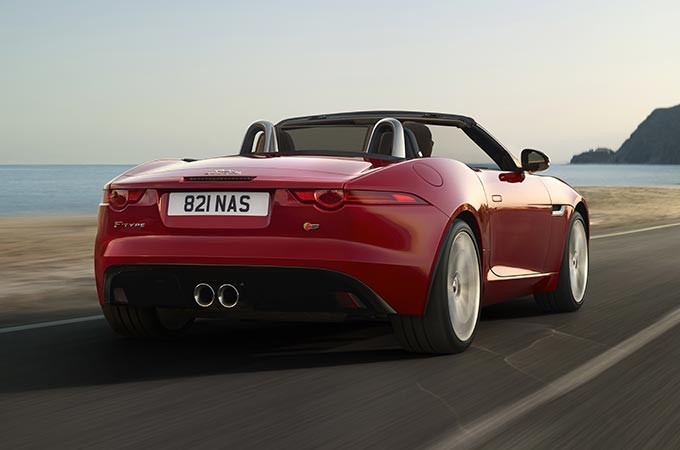 A Red F-TYPE Convertible Driving By The Sea.