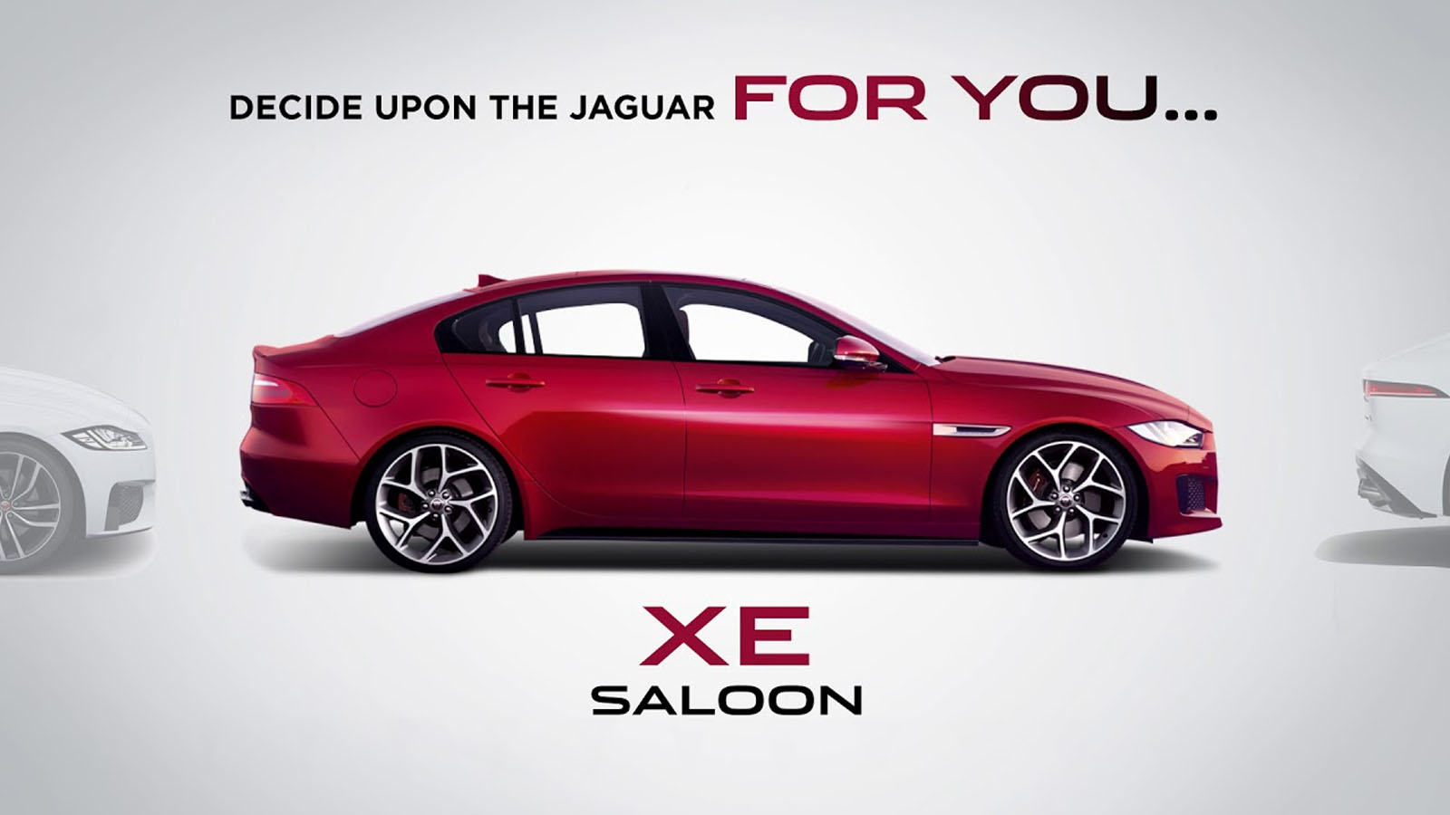 Side-view of a red Jaguar XE.