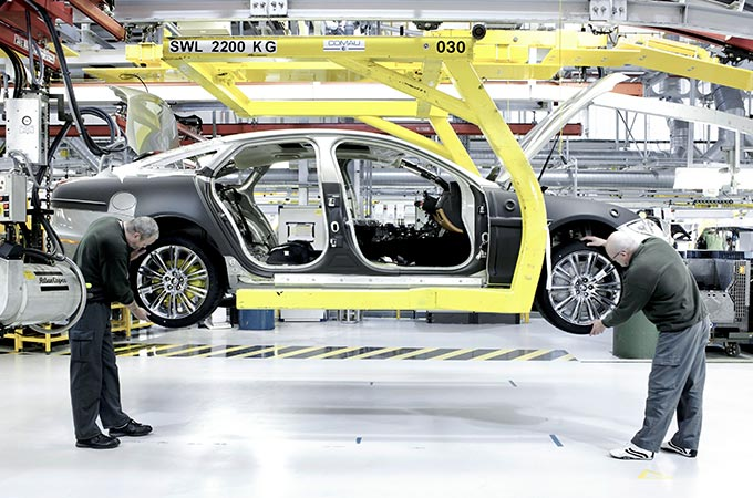 Jaguar vehicle being assembled in factory.