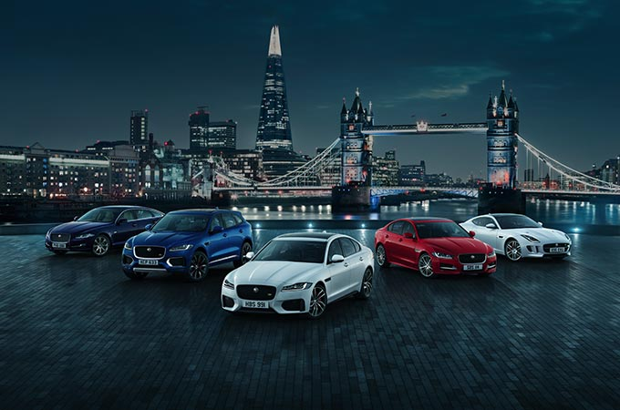 Jaguar range parked up with city backdrop.
