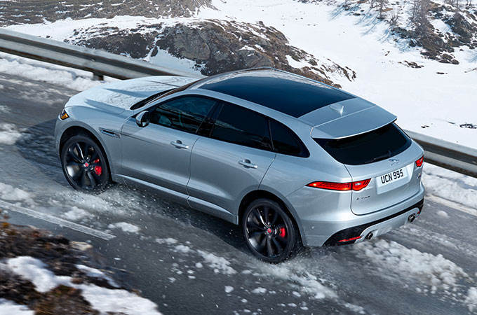 F-Pace driving in the snow.