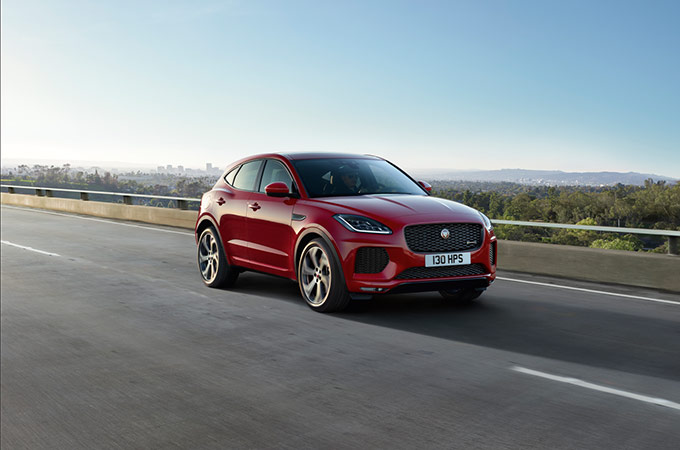 Red Jaguar E-PACE driving on-road.