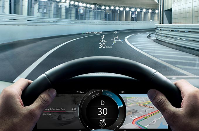 Jaguar I-PACE driving though a tunnel, with Virtual Heads Up Display.