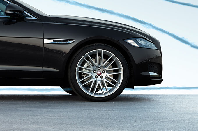 Side View Of Front Of A Black Jaguar XF.