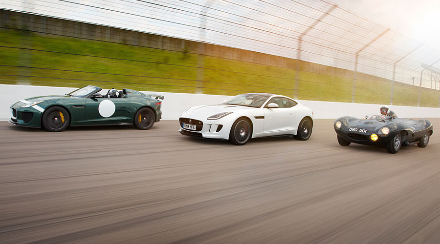 Three Jaguar Cars Racing.