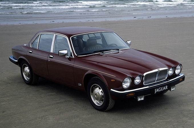 Red 1979 Jaguar XJ6 Series 3 On A Beach.
