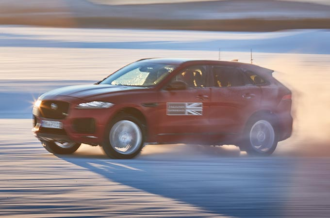 An F-PACE driving in the Snow.