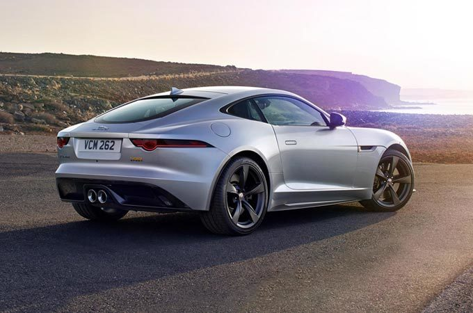 Silver Jaguar F-TYPE parked next to the sea
