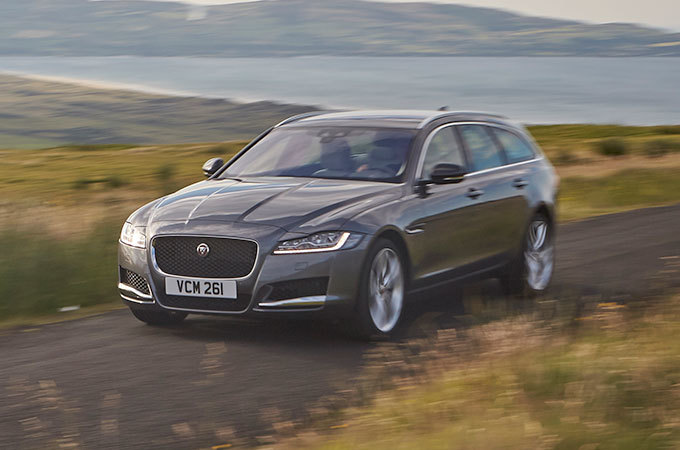 Jaguar XF Sportbrake driving along a country road, with the sea in the background