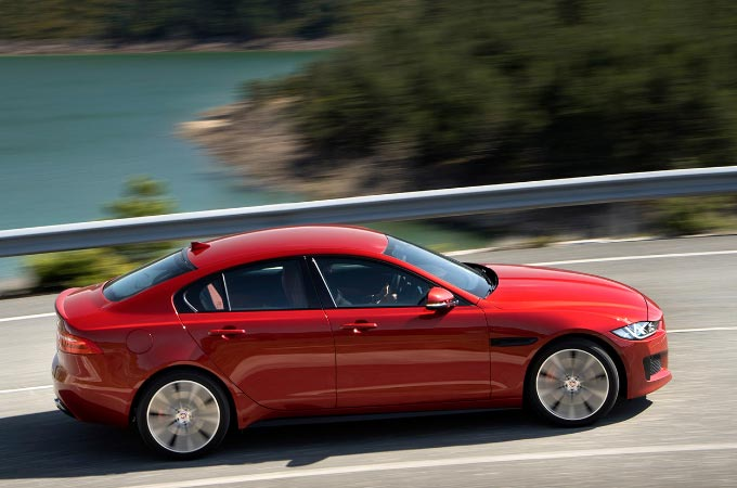 Side view of a red Jaguar XE