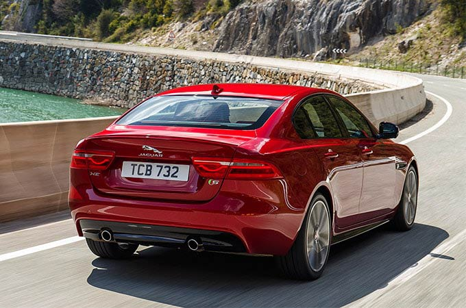 Rear view of a red Jaguar XE