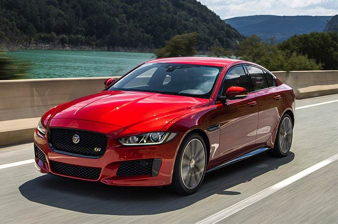 Front view of a red Jaguar XE
