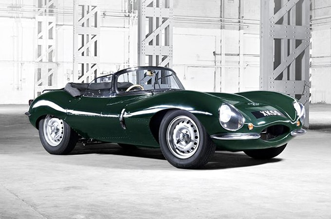 A Jaguar Classic is parked in a warehouse