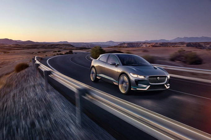 A Grey Jaguar I-PACE Driving In The Desert