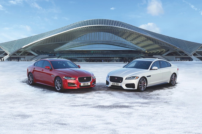 A Jaguar XE And XF Parked In The Snow