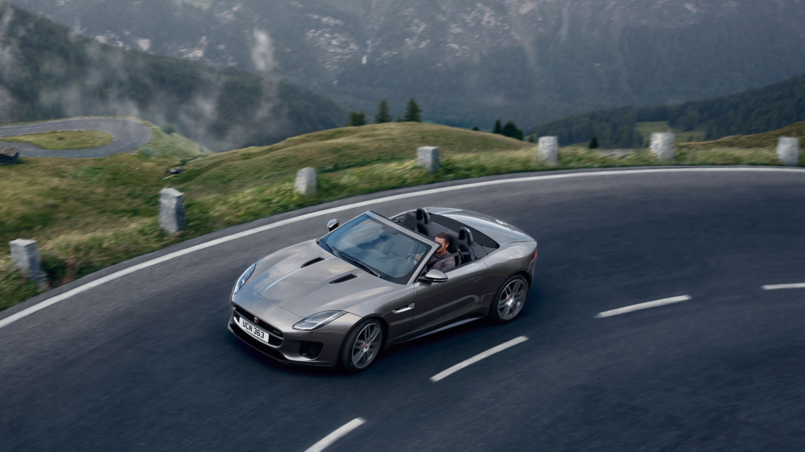Jaguar F-TYPE driving on a dark country road.