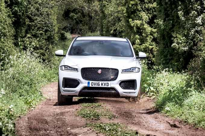 Front view of a white Jaguar F-PACE.