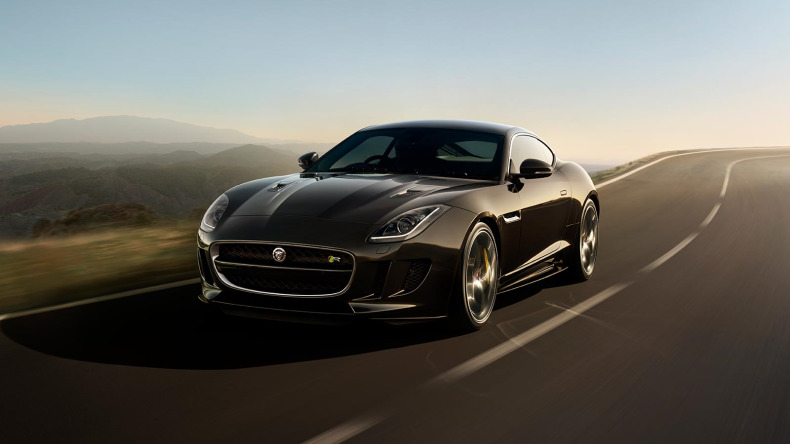 A Grey Jaguar F-TYPE Driving In The Countryside.