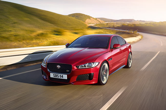 Jaguar XE S in red, driving on-road