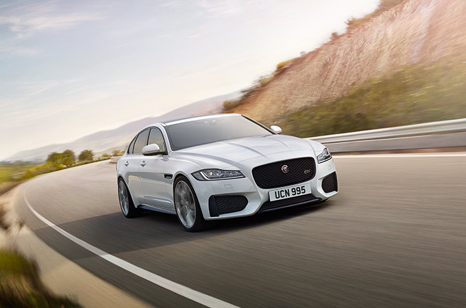 White Jaguar XF driving on-road