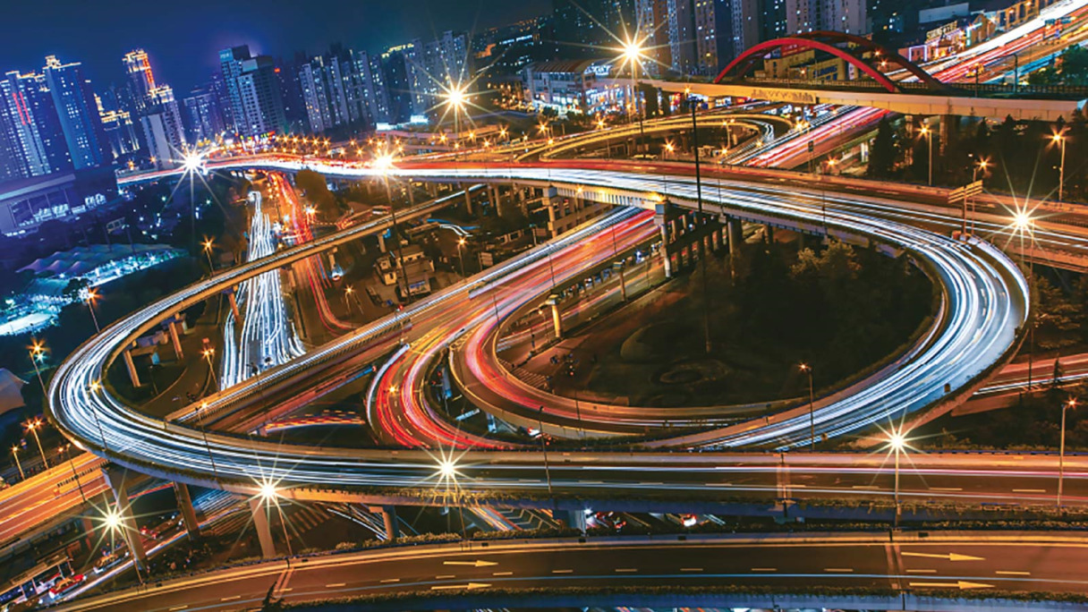 Slow shutter speed photo of a city environment background and winding roads