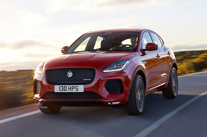 Red Jaguar E-PACE Driving Along A Road