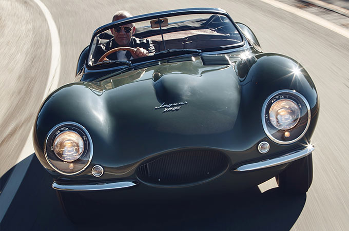 Man Driving In A Green Jaguar XKSS