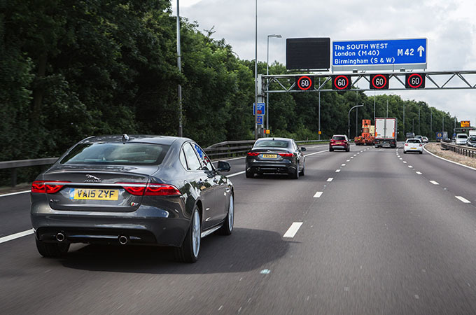 Jaguars Driving On A Motorway