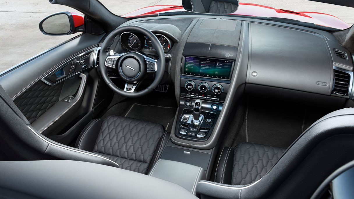 Interior of red Jaguar F-TYPE Coupé.