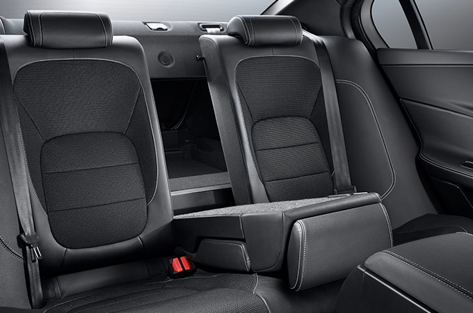 Up close shot of the rear seats in a Jaguar XE, with the middle seat folding downwards