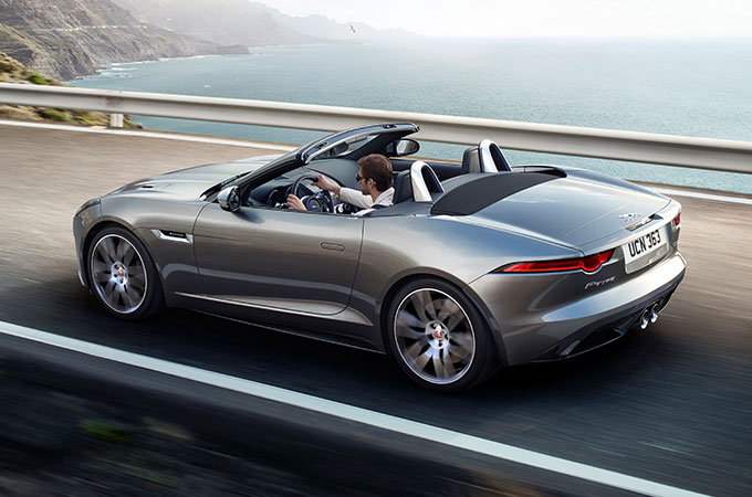 Grey F-TYPE Convertible driving on coastline.