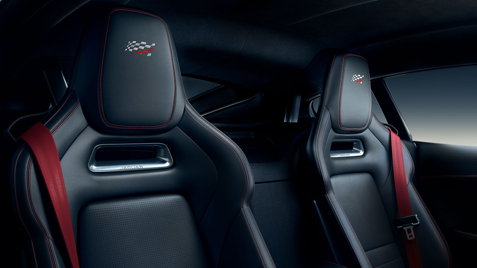 F-TYPE Checkered Flag Embossed Performance Seats with Red Seat Belts