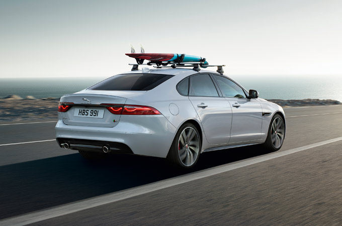 Jaguar With Surfboard On The Roof.
