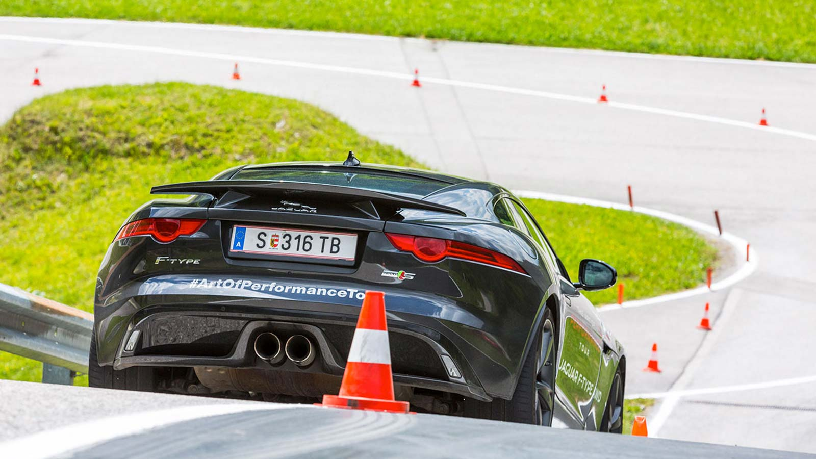 black f-type with traffic cone.