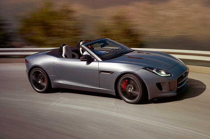 Grey F-TYPE SVR driving on road.