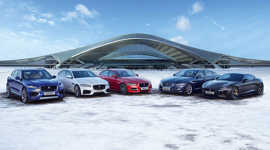 JAGUAR RANGE LINED UP IN SNOW.