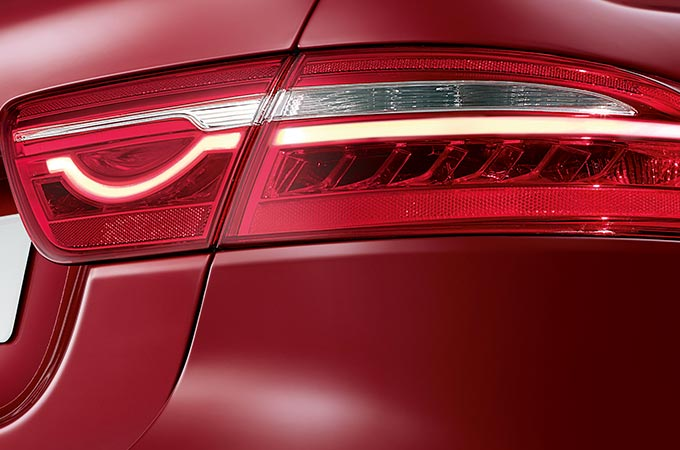 The rear-light of a red Jaguar XE