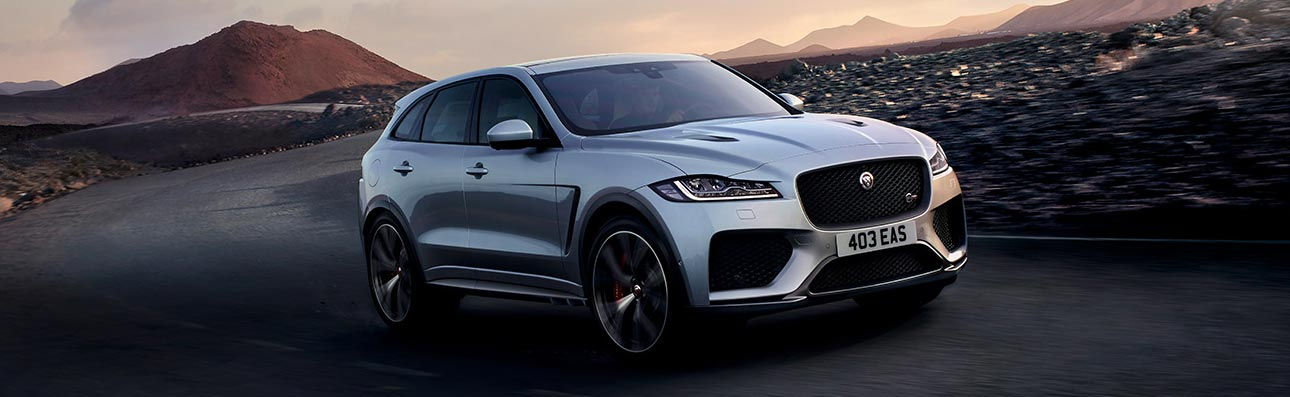 F-PACE driving in desert.