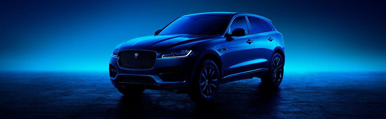 Jaguar F-PACE parked in mood lighting