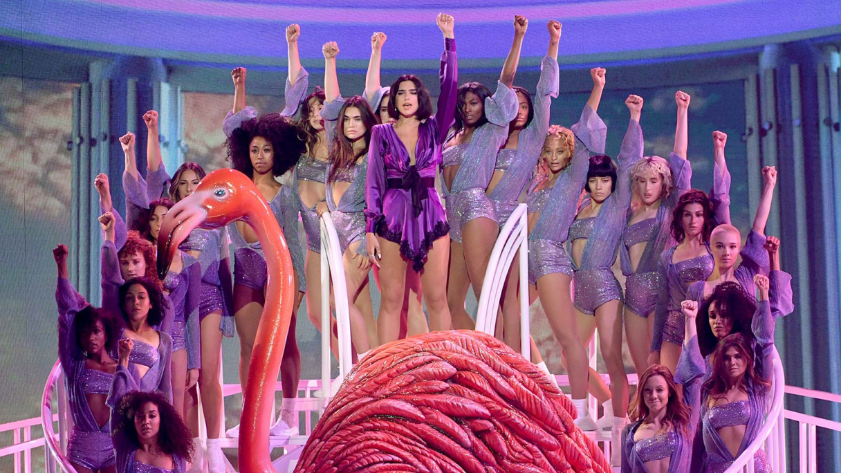 Dua Lipa in a group performance.
