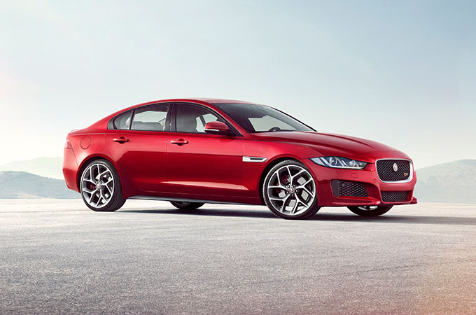 Red Jaguar XE parked up for display.