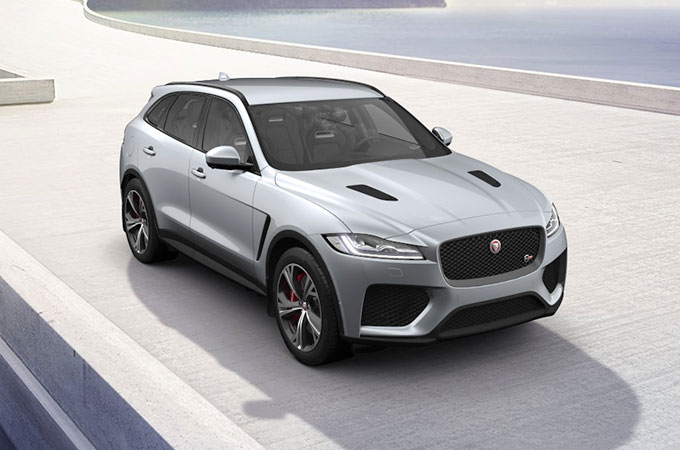 White Jaguar F-PACE SVR on pavement.